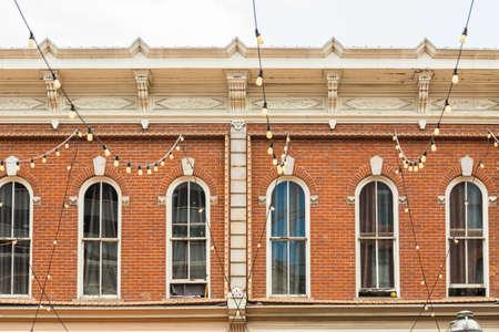 brick building: Windows of the hostorical brick building on Larimer Square. Stock Photo