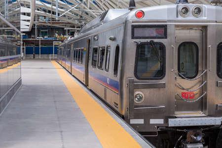 urban redevelopment: Denver, Colorado, USA-June 22, 2016.  Lightrail train ready for departure at the Denver Union Station. Editorial