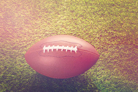 American Football Close up on on green grass. Stock Photo