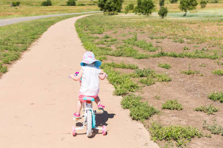 chatfield: Toddler learning how to ride her first bike.