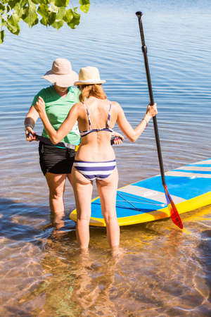 chatfield: Denver, Colorado, USA-July 13, 2016. Paddleboarding Instructor giving lessons to first timers. Editorial
