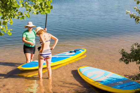 watersport: Denver, Colorado, USA-July 13, 2016. Paddleboarding Instructor giving lessons to first timers. Editorial