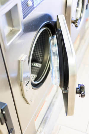 Industrial washing machines in a public laundry. Stok Fotoğraf