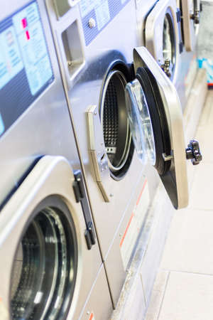 machines: Industrial washing machines in a public laundry. Stock Photo