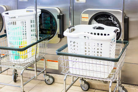 washing machines: Industrial washing machines in a public laundry. Stock Photo