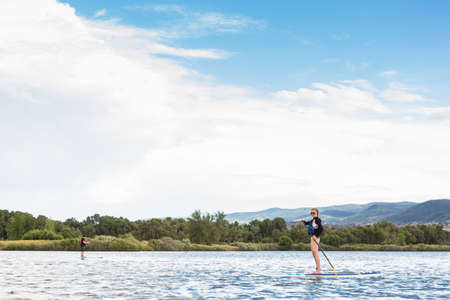 Denver, Colorado, USA-July 23, 2016. Recreational paddleboarding on small pond. Editorial