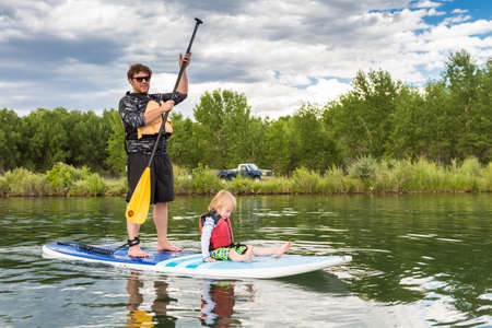 chatfield: Denver, Colorado, USA-July 23, 2016. Recreational paddleboarding on small pond. Editorial