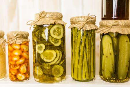 Homemade canned organic vegetables in glass jars.