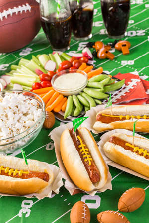 seltzer: Appetizers on the table for the football party. Stock Photo