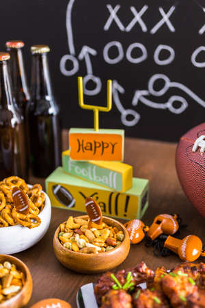 pretzel: Appetizers on the table for the football party. Stock Photo