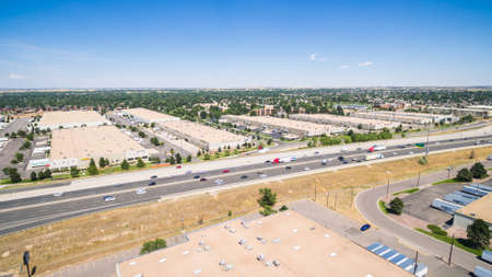 Denver, Colorado, USA-August 14, 2016. Aerial view of industrial park with highway. Editorial