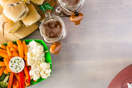 Sliders with veggie tray on the table for the football party. Stock Photo