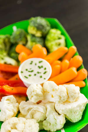 vegetable tray: Veggie tray on the table for the football party. Stock Photo