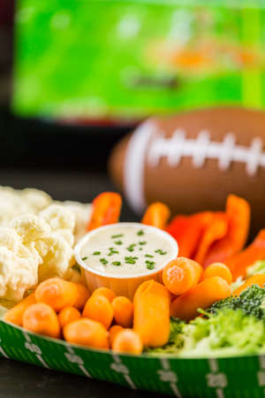 veggie tray: Sliders with veggie tray on the table for the football party. Stock Photo