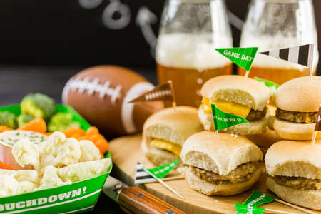 party tray: Sliders with veggie tray on the table for the football party. Stock Photo