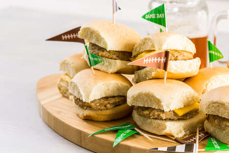 jarra de cerveza: Sliders with veggie tray on the table for the football party. Foto de archivo