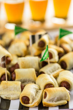 encendedores: Sliders with veggie tray on the table for the football party. Foto de archivo