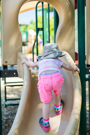 play the old park: Toddler playing at outdoor playground.
