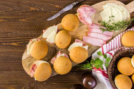 Ham and cheese sliders on homemade dinner rolls. Stock Photo