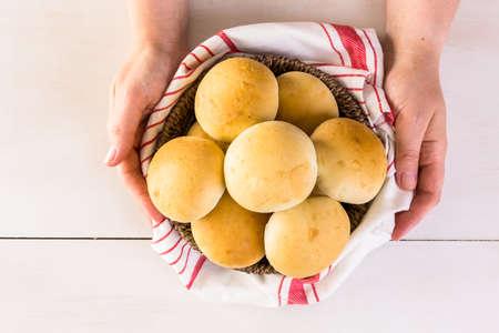 fingers on top: Baking fresh homemade dinner rolls.