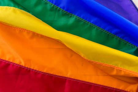 Rainbow Gay Pride flag background.