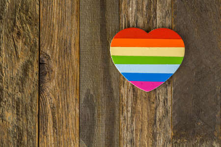 homosexuals: Rainbow Gay Pride heart sign on a wood background