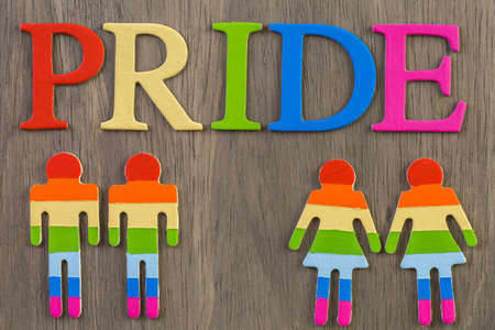 Rainbow Gay Pride sign on wood background.