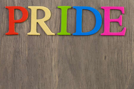 homosexuals: Rainbow Gay Pride sign on wood background.