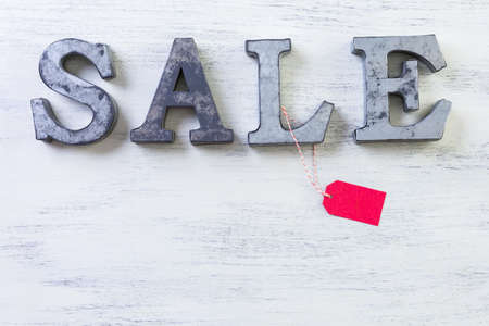 tagged: Tags with sale sign on wood board. Stock Photo