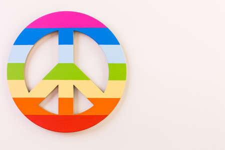 Rainbow Gay Pride peace sign on a white background.