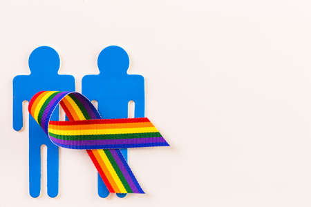 nad: Rainbow Gay Pride male nad female cutouts on a white background. Stock Photo