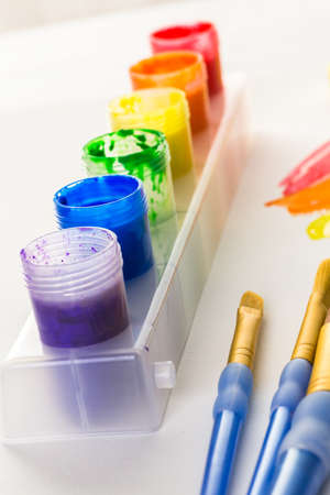 mode made: Colorful paint on a white background.