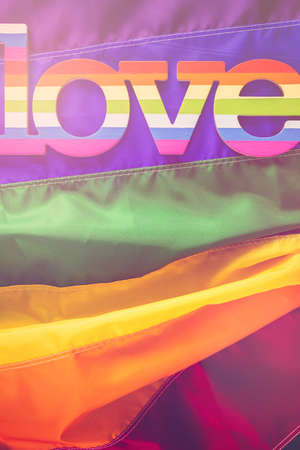 transgender gay: Rainbow Gay Pride flag with Love sign. Stock Photo