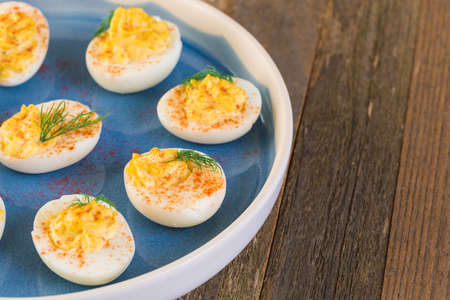 Deviled eggs garnished with fresh dill.