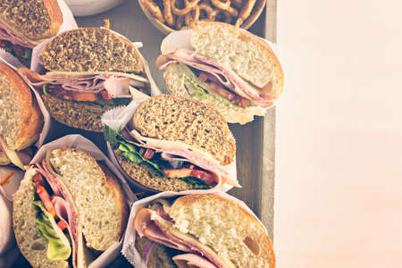 hero sandwich: Fresh sub sandwich on white and wheat hoagies. Stock Photo