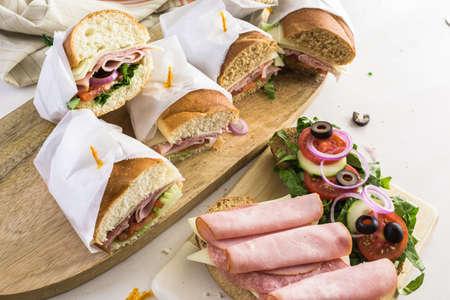 Step by step. Fresh sub sandwich on white and wheat hoagies.
