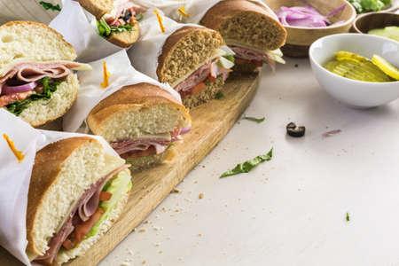 Fresh sub sandwich on white and wheat hoagies. Stock Photo