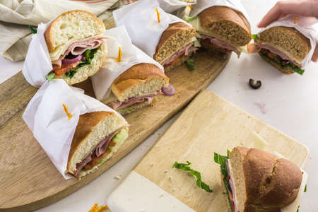 hero sandwich: Step by step. Fresh sub sandwich on white and wheat hoagies.