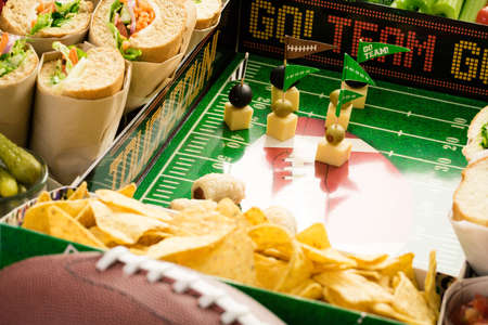Football Snack Stadium filled with sub sandwiches, veggies and chips.