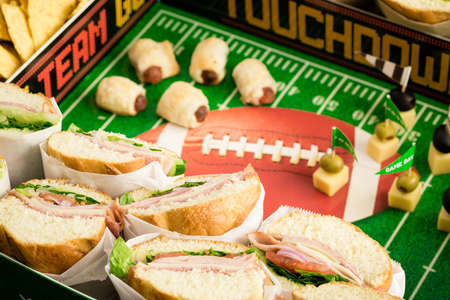 american hero: Football Snack Stadium filled with sub sandwiches, veggies and chips.