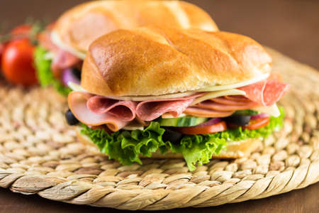 hoagie: Sub sandwich with fresh vegetables, lunch meat and cheese on hoagie roll.