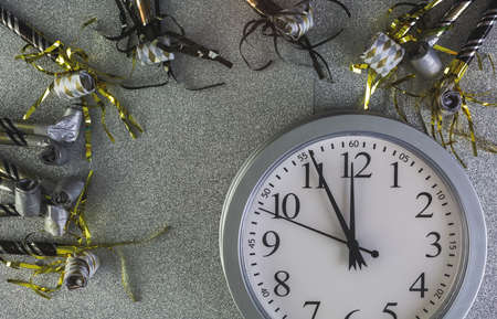 New Year Eve party decorations on silver background.