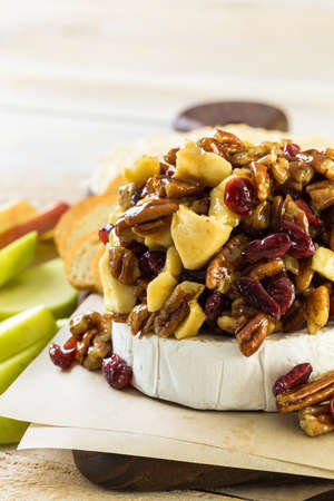 Caramel nut and cranberry brie appetizer for Christmas party.