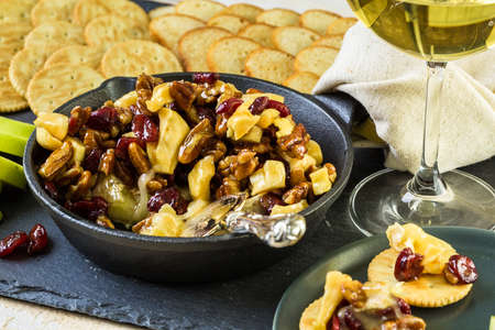 brie: Caramel nut and cranberry brie appetizer for Christmas party.