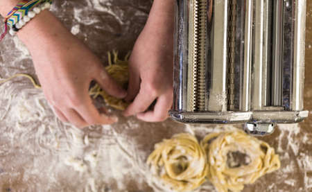 home made: Preparing home made pasta with pasta maker.