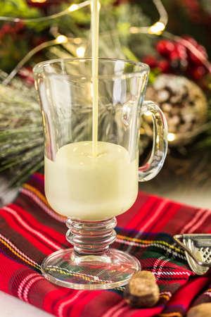 Traditional holiday egg nog garnished with freshly ground nutmeg. Stock Photo