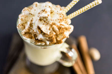 chantilly: Traditional holiday drink egg nog garnished with whipped cream in the glass.