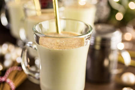 Traditional holiday drink egg nog garnished with nutmeg. Stock Photo