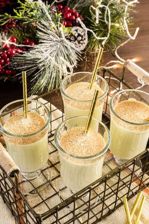 Traditional holiday drink egg nog garnished with nutmeg. Stock Photo