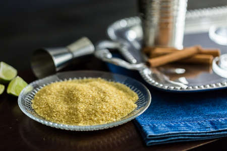 Brown sugar in small plate for rimming coccktail glasses.
